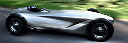 "August 16, 2017 - inconnu - A newconcept car inspired by classic racing cars has been unveiled by upmarket Nissan off-shot brand Infiniti.The Prototype 9 is an all-electric motor with designers imagining what an Infinity race car might have looked like in the 1940s – even though the firm is less than 30 years old.The Prototype 9 was hand-built by a small team as an ""out-of-work hours"" project and combines a 70-year-old design with latest electric tech.Under the bonnet is a electric motor from parent company Nissan's Advanced Powertrain Department that will pump out 148bhp – although it's only good for 20 minutes of track use before needing a recharge.It's a rear-wheel drive racer and can reach 0-62mph in 5.5 seconds and hit a top speed of 106mph.The body is made from steel panels wrapped around a ladder frame with panels hammered into shape by craftsmen.The entire design takes inspiration from Japanese motorsport and aeronautic design.There's an exposed cockpit, open-wheel layout, 19-inch wire-spoke wheels and the double arch-grille that can be modern on modern day Infiniti vehiclesThe single-seater cabin is handmade with contrast red stitching and Japanese flags etched into the headrest.The speedo and other instrument dials are fitted into the centre of the steering wheel rather than on a traditional dash with the steering wheel rotating around the hub.Infiniti global design chief Alfonso Albaisa said: ""We discussed the idea of chancing upon an unrecognised race car, hidden away for decades in a barn, deep in the Japanese countryside.""We wanted to explore what this looked like, what it would have been made of.""Open-wheeled racers of the age were beautiful machines, elegant and powerful and with a wonderful purity of purpose.""It's an automotive fantasy, but the notion captured our imaginations enough to put pencil to paper.""Chairman and global president Roland Krueger aid a ma"