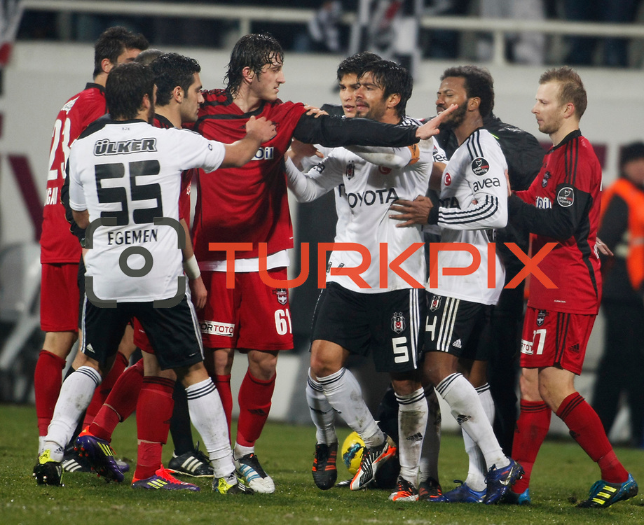 Besiktas's Ibrahim Toraman (C) during their Turkish superleague soccer match Besiktas between Gaziantepspor at BJK Inonu Stadium in Istanbul Turkey on Tuesday, 05 January 2012. Photo by TURKPIX