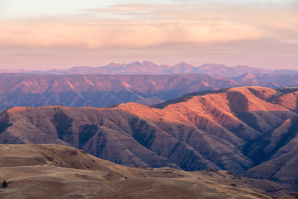 Sunset over Hells Canyon in Northeast Oregon with Idaho's Seven Devils Mountains in the background.