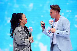 Demi Lovato and Roman Kemp on stage during Capital's Summertime Ball with Vodafone at Wembley Stadium, London.
