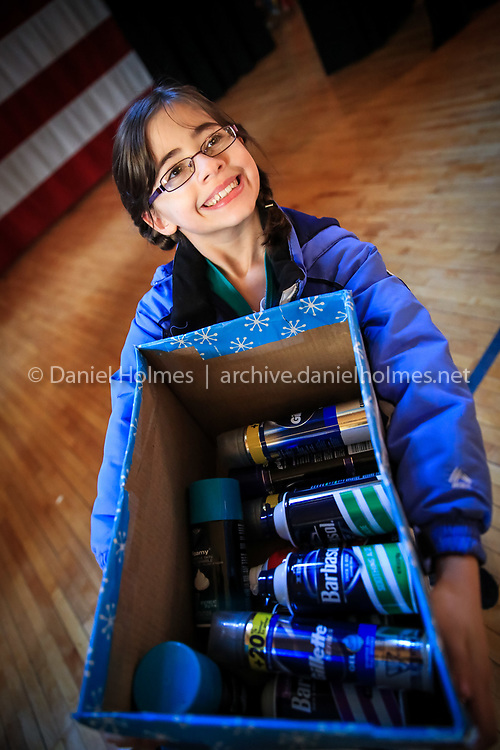 (2/1/14, FRAMINGHAM, MA) Katie Najarian from Framingham Girl Scout Junior Troop 75412 carries donated toiletries to Town Hall in Framingham on Saturday. The Girl Scouts collected toiletries for local homeless veterans and delivered them to Peter Harvell, Director of Veterans Services, at the Town Hall. Daily News and Wicked Local Photo/Dan Holmes