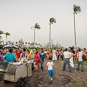 People enjoying an evening stroll on the  waterfront boardwalk in Casco Viejo in Panama City, Panama.