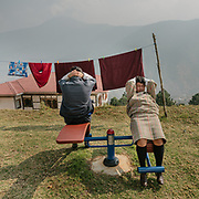 Visitors at the nunnery doing work out. The Sangchhen Dorji Lhuendrup Nunnery is perched on a hilltop overlooking the Punakha valley and Wangduephodrang valley. The nunnery has several hundred women staying and studying the principles of buddhism.