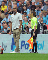Football - 2019 FA Community Shield - Liverpool vs. Manchester City<br /> <br /> Lines Woman,Sian Massey - Ellis helps Man City Manager Pep Guardiola to calm down, at Wembley Stadium.<br /> <br /> COLORSPORT/ANDREW COWIE