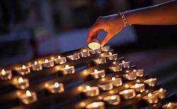 THEMENBILD - URLAUB IN KROATIEN, eine junge Frau zündet eine Kerze an in der Kirche der heiligen Euphemia aufgenommen am 03.07.2014 in Rovinj, Kroatien // a young woman lights a candle in the St. Euphemias Basilica in Rovinj, Croatia on 2014/07/03. EXPA Pictures © 2014, PhotoCredit: EXPA/ JFK