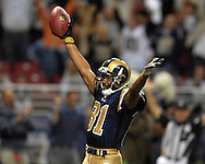 St. Louis Rams wide receiver Torry Holt (81) celebrates after scoring a late fourth quarter touchdown, giving the Rams a 28-27 lead over Seattle at the Edward Jones Dome in St. Louis, Missouri, October 15, 2006.  The Seahawks beat the Rams 30-27.<br />