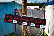 """Glastonbury Festival, 2015.<br /> """"Tits and Shags this way"""" sign to the RSPB bird protection stall"""
