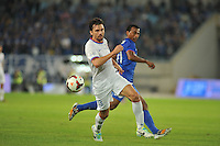 Paulo Andre of Shanghai Shenhua, front, dribbles against Jiangsu Sainty during their 28th round match of the 2014 Chinese Football Association Super League in Nanjing city, east China's Jiangsu province, 18 October 2014.<br /> <br /> Jiangsu Sainty drew with Shanghai Shenhua 1-1.