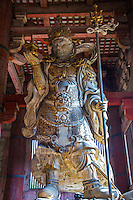 """Tamon-ten Guardian at Daibutsuden, Todaiji - Todai-ji or the Eastern Great Temple in Nara - the Great Buddha Hall Daibutsuden shelters the world's largest bronze statue of the Buddha known in Japanese as Daibutsu.  The temple also serves as the Japanese headquarters of the Kegon sect of Buddhism. The temple is a listed UNESCO World Heritage Site as """"Historic Monuments of Ancient Nara"""".  Wild deer, regarded as messengers of the gods in the Shinto religion, roam the area regularly."""