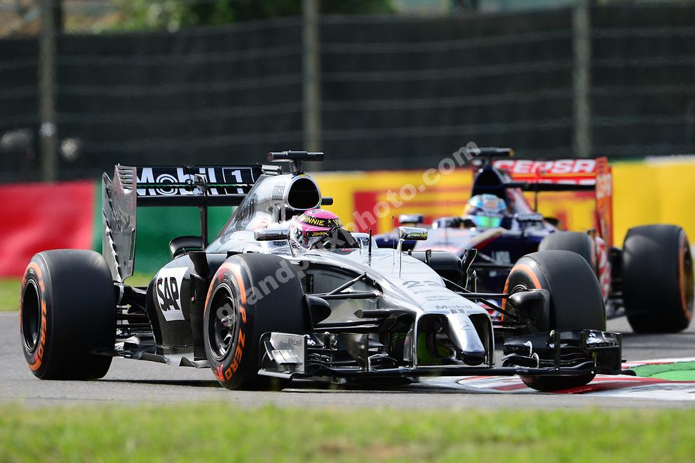 Jenson Button (McLaren-Mercedes) leads Jean-Eric Vergne (Toro Rosso-Ferrari) during qualifying for the 2014 Japanese Grand Prix in Suzuka. Photo: Grand Prix Photo