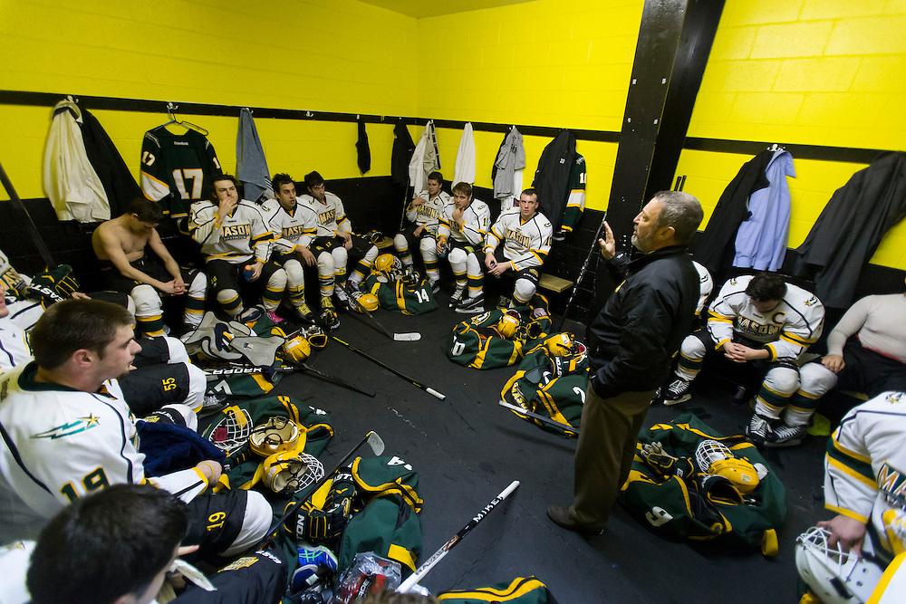 Head Coach Steve Hyjek talks to his team in the locker room during the first intermission against #8 ranked Christopher Newport University at Hampton Roads Iceplex in Newport News, VA on January 25, 2014.