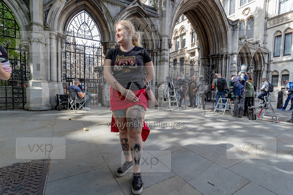 Chloe Fawkes, 21 a fan of American actor Johnny Depp, posing in front of Royal Court of Justice in London, on Monday, July 13, 2020, showing her tattoo made with Johnny Depp's pirate of the Caribbean film character. (VXP Photo/ Vudi Xhymshiti)