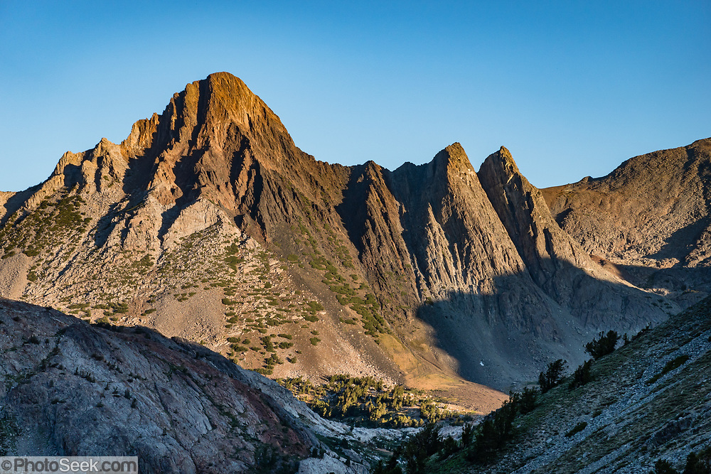 Sunrise on Virginia Peak (in Yosemite National Park) seen from Summit Lake in Hoover Wilderness of Humboldt-Toiyabe National Forest, in the Eastern Sierra Nevada, Mono County, California, USA. Our backpack from Green Creek Trailhead to Summit Lake was 7.6 mi with 2360 ft gain, 310 ft descent, over a leisurely 3 days, then out on the fourth day.