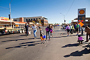 28 JANUARY 2012 - BUCKEYE, AZ:  Participants in the Buckeye Days parade throw candy to children along the parade. The Buckeye Days parade went through downtown Buckeye, AZ, an agricultural community about 45 miles west of Phoenix. The parade was one the first events to mark Arizona's centennial celebration. Arizona was admitted to the United States on Feb 14, 1912, making it the 48th state in the union. The state celebrates its 100th birthday with a series of events on Feb. 14, 2012.      PHOTO BY JACK KURTZ