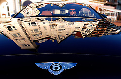 """KNOKKE, BELGIUM - AUGUST-2-2005 - A Bentley which costs 185,000 Euros, cruises Albertplien, which is also known to locals as Place M'as tu vu """" Did you see me? """". (Photo © Jock Fistick)"""