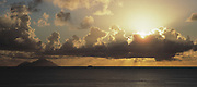 Panoramic view of the island of Saba at sunset in the caribbean with cruise ship on the horizon