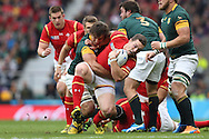 George North of Wales is hauled down by Eben Etzebeth of South Africa. Rugby World Cup 2015 quarter final match, South Africa v Wales at Twickenham Stadium in London, England  on Saturday 17th October 2015.<br /> pic by  John Patrick Fletcher, Andrew Orchard sports photography.
