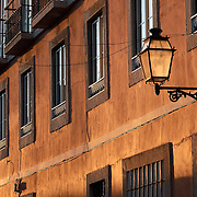 Traditional lamp on Lisbon's Bairro alto at sunset