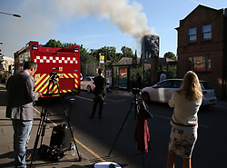 Emergency services and media at the scene after a fire engulfed the 27-storey Grenfell Tower in west London.