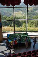 Visitors to the Dora Observatory on the South Korean side of the DMZ look at a map detailing the view outside the window, including a border fence between South and North Korea.. (September 29, 2019)