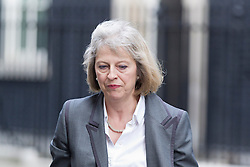© Licensed to London News Pictures. 10/09/2013. London, UK. The Home Secretary, Theresa May, is seen on Downing Street in London today (10/09/2013) after a meeting of the British Government's cabinet. Photo credit: Matt Cetti-Roberts/LNP