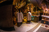 A Roman Catholic Mass in the Church of the Holy Sepulchre (site of the last five stations of the Cross and venerated as the place where Jesus was crucified and buried), the Christian Quarter, Old City, Jerusalem, Israel.