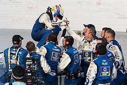 October 7, 2018 - Dover, DE, U.S. - DOVER, DE - OCTOBER 07: Chase Elliott climbs out of his #9 NAPA Auto Parts Chevrolet and gets congratulated by his crew after winning the Gander Outdoors 400 on October 07, 2018, at Dover International Speedway in Dover, DE. (Photo by David Hahn/Icon Sportswire) (Credit Image: © David Hahn/Icon SMI via ZUMA Press)