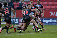 Zak Hardaker (3) of Wigan Warriors is held up while attempting to score a try