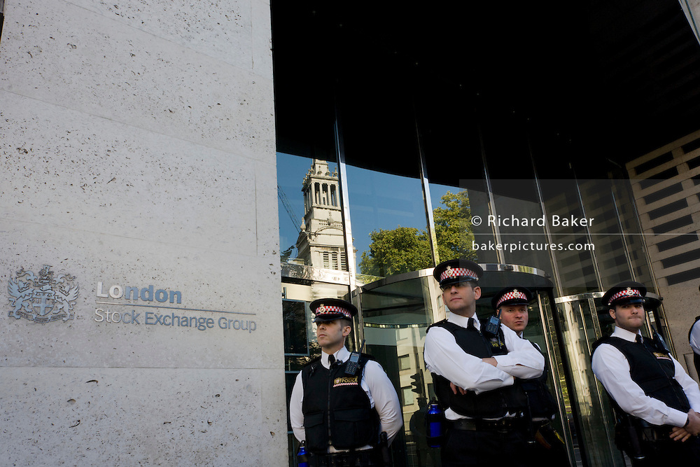 City of London police officers guard the Stock Exchange premises near Paternoster Square n the City of London during world corporate greed and government austerity measures protests.