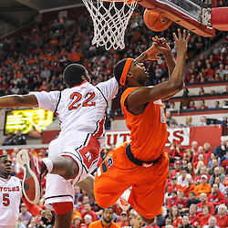 Rutgers Scarlet Knights forward Kadeem Jack (22) knocks the ball away from Syracuse Orange forward C.J. Fair (5) during first half NCAA Big East basketball action between #2 Syracuse and Rutgers at the Louis Brown Athletic Center. Syracuse leads 40-34 at halftime.