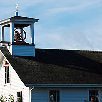 1800's firehouse bell tower fully restored and operational, in Damariscotta, Maine.