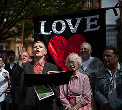 """© Licensed to London News Pictures . 16/08/2015 . Manchester , UK . Actor MAXINE PEAKE amongst people reading an account of the """" Peterloo """" massacre at a memorial at the site of St Peter's Field , where fifteen people were killed during a cavalry charge on a democracy protest , 196 years ago (16th August 1819) . Photo credit : Joel Goodman/LNP"""