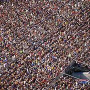 Fans fill the seats on the front stretch during the NASCAR Coke Zero 400 Sprint series auto race at the Daytona International Speedway on Saturday, July 6, 2013 in Daytona Beach, Florida.  (AP Photo/Alex Menendez)