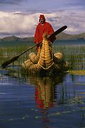 Aymara Indian & Totora Reed Boat<br />Lake Titicaca<br />BOLIVIA.  South America
