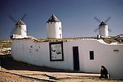 Whitewashed windmills in La Mancha at Campo de Criptana, Spain.