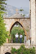 Men speak outside a church in the small, coastal town of Byblos in Lebanon
