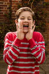 Portrait of Young Boy Shouting Outdoors