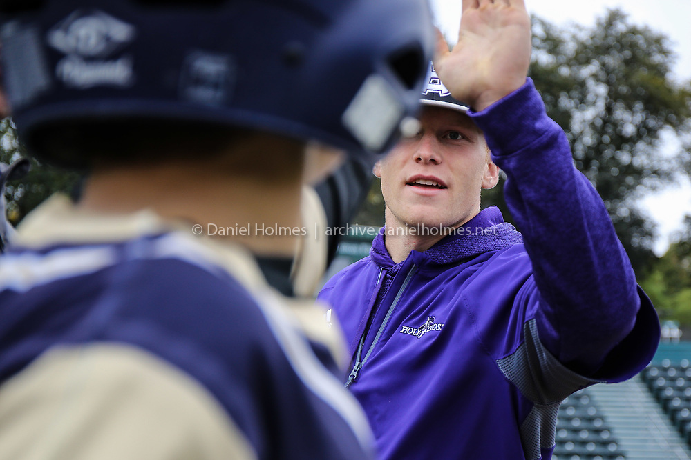 WORCESTER -  Holy Cross' Garret Keough offers a high-five during the baseball event between disables athletes and the Holy Cross baseball team at Hanover Insurance Park in Worcester on Saturday October 12, 2019. The event was a combined effort between the Beautiful Lives Project, Shrewsbury Little League Challenger Division and Holy Cross baseball team. The Crusaders worked with disabled athletes to try some hitting, fielding and bonding. [Photo/Dan Holmes]