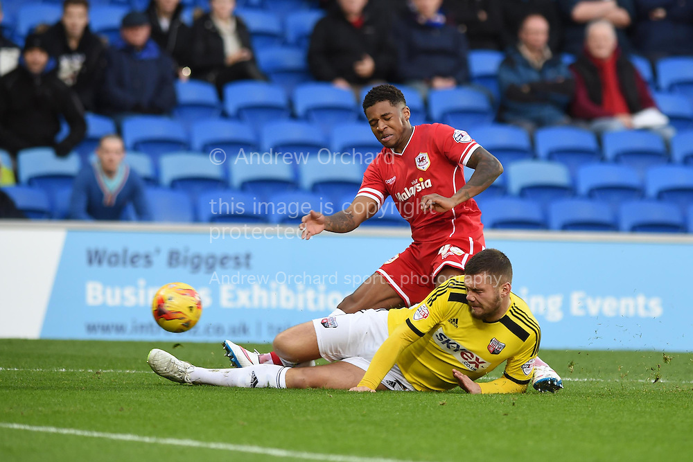 Kadeem Harris of Cardiff city is tackled by Brentford's Harlee Dean. Skybet football league championship match, Cardiff city v Brentford at the Cardiff city stadium in Cardiff, South Wales on Saturday 20th December 2014<br /> pic by Andrew Orchard, Andrew Orchard sports photography.