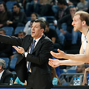 Efes Pilsen's coach Ufuk SARICA (L) during their Turkish Basketball league match Efes Pilsen between Banvit at the Sinan Erdem Arena in Istanbul Turkey on Saturday 02 April 2011. Photo by TURKPIX
