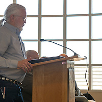 The Honorable Jackie McKinney, Mayor of Gallup, speaks at the podium to the city council members on his stance for gun control at the McKinley County Courthouse council chambers in Gallup Wednesday.