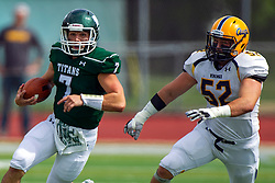 BLOOMINGTON, IL - September 28:  Brandon Bauer breaks into the Vikings backfield on an option with Luke Sawicki hustling to make the from behind stop during a college football game between the IWU Titans and the Augustana Vikings on September 28 2019 at Wilder Field in Tucci Stadium in Bloomington, IL. (Photo by Alan Look)
