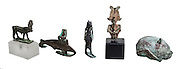 Five Egyptian bronze figurines 1st millennium BCE from left to right Apis Bull, fish, Lioness Goddess Sekhmet, bust of Osiris and Headgear