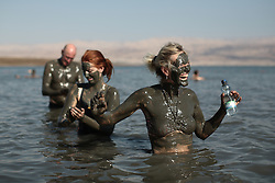 Bathers in the Dead Sea cover themselves in mud, which is reputed to have beneficial effects for the skin. From a series of photos commissioned by  British NGO, Medical Aid for Palestinians (MAP).