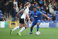 AFC Wimbledon defender Paul Kalambayi (30) taking on Gillingham attacker Tom Eaves (9) during the EFL Sky Bet League 1 match between AFC Wimbledon and Gillingham at the Cherry Red Records Stadium, Kingston, England on 23 March 2019.