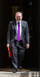 London, July 18th 2017. In a clear demonstration of unity with a cabinet that has seemed to be split over Brexit and other issues,  Government ministers, L-R Scotland Secretary David Mundell leaves the last cabinet meeting together before the Parliamentary summer recess at Downing Street in London.