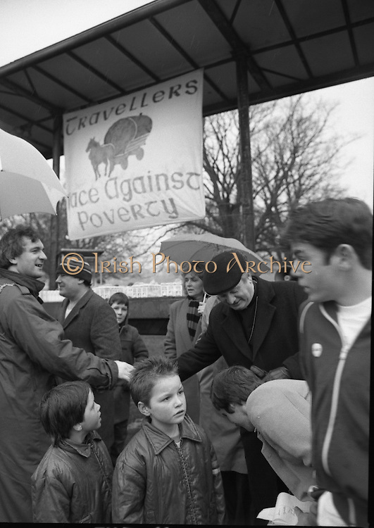 First All-Traveller Mini Marathon.    (R53)..1987..05.04.1987..04.05.1987..5th April 1987..Today saw the running of the first All-Traveller Mini Marathon in aid of Trocaire the World Aid Agency. The race was run over a 10k course in the Phoenix Park, Dublin. Bishop Eamon Casey a patron of the charity was on hand to lend support...Image of Bertie Ahern TD, Lord Mayor of Dublin and Bishop Eamon Casey meeting with some children at the race start point.
