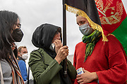 """A refugee attending a demonstration is comforted by fellow protesters as she breaks down in tears. When asked about her story she said that she is in Germany with her children, while her husband remains in Afghanistan (uncertain if they will be able to reunite), Germany, August 17, 2021. About 1000 people gathered in front of the  under the call """"Airlift now! Create safe escape routes from Afghanistan!"""", the spontaneous event was organized by Seebrücke and several other human-rights organizations."""