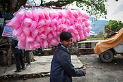 A teenage boy selling pink cotton candy outside a fairground on the 6th of March 2020 in Paudi, Sundarbazar, Lamjung District, Gandaki Pradesh, Nepal.  The fairground is part of the Holi celebrations, also known as Festival of Colours, is one of the most popular festivals in Nepal. It takes place on the full moon day in Nepali Fagu month (February to March in Solar Calendar) and lasts for 2 days. (photo by Andrew Aitchison / In pictures via Getty Images)