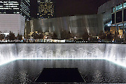 One World Trade Center complex site with museum and illuminated 9/11 Memorial South Pool in New York, USA
